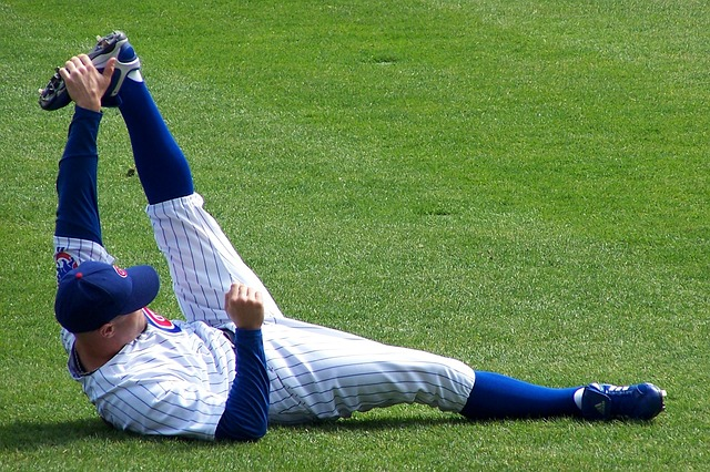 A Chicago Cubs baseball player stretching