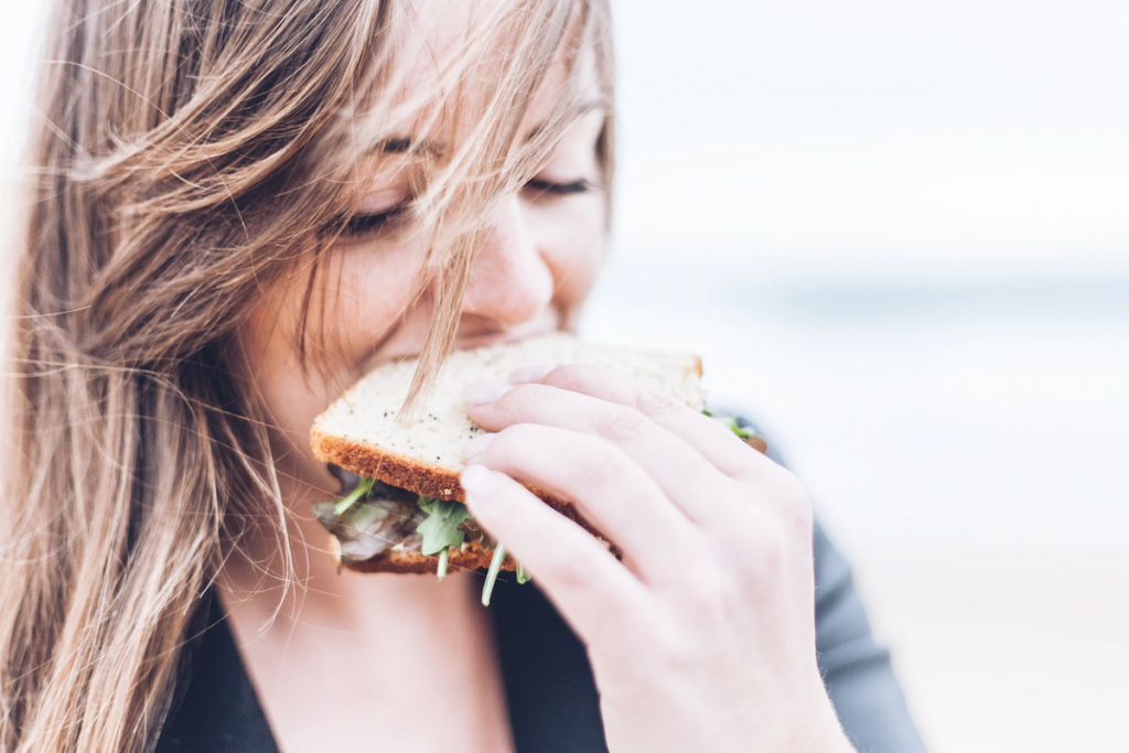 Women eating a healthy sandwich.